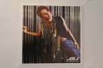 The Beginning photocard 7 Junsu Xia red hair leather tags blue pants
