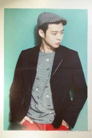 Park Yoochun Micky from JYJ poster grey shirt bang black Jacket hat short hair make up red pants turquoise background